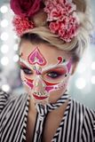Young beautiful woman with skull makeup. Mexican day of the dead. Art in the style of sugar skulls royalty free stock photography