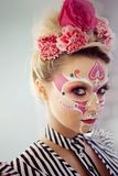 Young beautiful woman with skull makeup. Mexican day of the dead. Art in the style of sugar skulls royalty free stock image