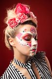 Young beautiful woman with skull makeup. Mexican day of the dead. Art in the style of sugar skulls royalty free stock images