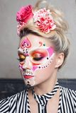 Young beautiful woman with skull makeup. Mexican day of the dead. Art in the style of sugar skulls stock image
