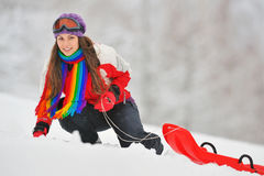 Young Beautiful Woman and sledge Royalty Free Stock Photo
