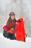 Young Beautiful Woman and sledge Royalty Free Stock Image