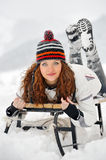Young Beautiful Woman on sledge Royalty Free Stock Image