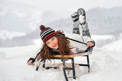 Young Beautiful Woman on sledge Stock Images