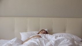 Young beautiful woman sleeping in the bed. Stock Photo