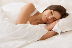 Young Beautiful Woman Sleeping on Bed Royalty Free Stock Photos