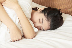 Young beautiful woman sleeping in bed Stock Photos