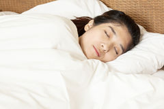Young beautiful woman sleeping in bed Stock Images