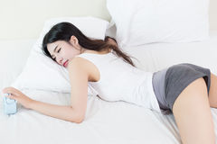 Young beautiful woman sleeping on bed Stock Photos