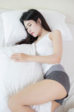 Young beautiful woman sleeping on bed Royalty Free Stock Image