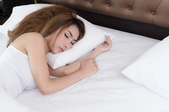 Young beautiful woman sleeping on bed Royalty Free Stock Photography