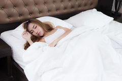Young beautiful woman sleeping on bed Stock Images