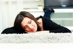 Young beautiful woman sleeping on the carpet Royalty Free Stock Photography