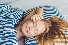 Young beautiful woman sleeping in her bed and relaxing in the mo. Rning Stock Image