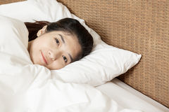 Young beautiful woman sleeping and smile in morning Stock Image