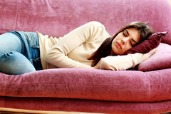Young beautiful woman sleeping on the sofa Stock Image