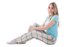 Young beautiful woman in sleepwear sitting isolated on white Royalty Free Stock Images