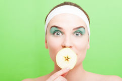 Young beautiful woman with a slice of apple Stock Photo