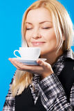 Young beautiful woman smelling coffee Royalty Free Stock Photos