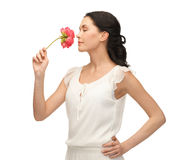 Young and beautiful woman smelling flower royalty free stock image