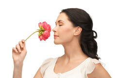 Young and beautiful woman smelling flower Stock Photos