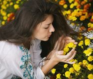 Woman smelling flowers. stock images
