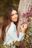 Young beautiful woman smells flowers Royalty Free Stock Photography