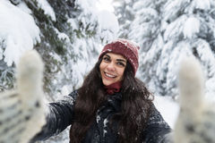 Young Beautiful Woman Smile Camera Taking Selfie Photo In Winter Snow Forest Girl Outdoors Royalty Free Stock Photography
