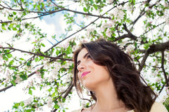 Young beautiful woman smiling and enjoying spring  Stock Images