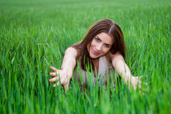 Young beautiful woman smiling in green field Royalty Free Stock Photo