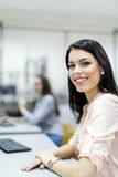 Young beautiful woman smiling happily in a classroom Stock Photos