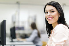 Young beautiful woman smiling happily in a classroom Stock Images