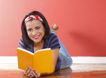Young beautiful woman smiling holding book Stock Image