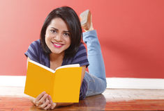 Young beautiful woman smiling holding book Royalty Free Stock Image