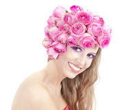 Young beautiful woman smiling portrait. Young beautiful woman with pink flowers, bright make up and wide smile Royalty Free Stock Image