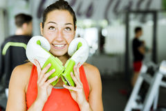 Young beautiful woman smiling and posing with boxing gloves Stock Image