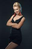 Young beautiful woman smiling posing in studio Royalty Free Stock Photos