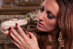Young beautiful woman with snake Stock Photos