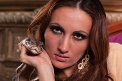 Young beautiful woman with snake Stock Images