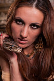 Young beautiful woman with snake Royalty Free Stock Image