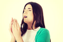 Young beautiful woman is sneezing. Stock Photography