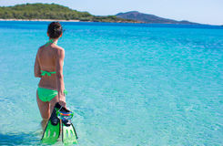 Young beautiful woman with snorkel in blue sea Stock Image
