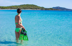 Young beautiful woman with snorkel in clear sea Royalty Free Stock Image