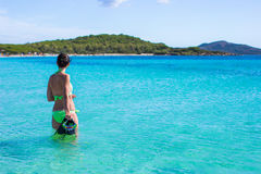 Young beautiful woman with snorkel in clear sea Royalty Free Stock Images