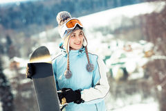 Young beautiful woman with snowboard Royalty Free Stock Photo