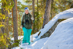Young beautiful woman with snowshoes chill out in the forest Stock Photography
