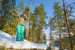 Young beautiful woman with snowshoes chill out in the forest Stock Image