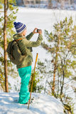 Young beautiful woman with snowshoes and mobile phone chill out Stock Images