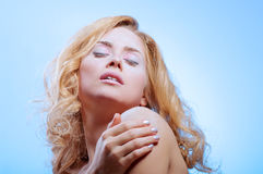 Young beautiful woman with snowy skin Royalty Free Stock Images