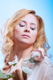 Young beautiful woman with snowy skin Stock Image